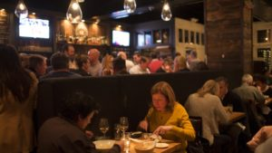 Customers dining in a loud restaurant