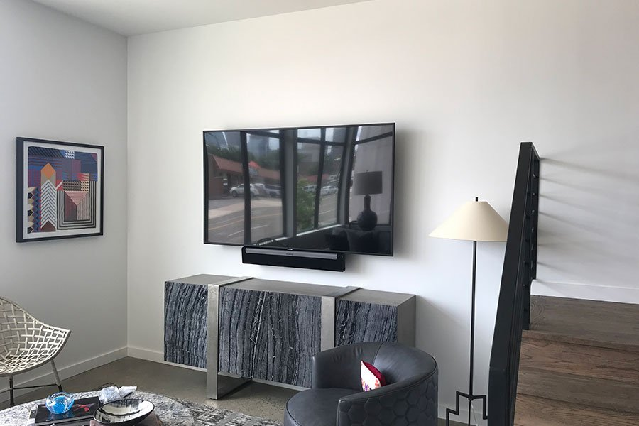 Professional Home Audio and TV Installation Sonos surround sound installed. Living Room setup with Sonos Soundbar with Artisan rear speakers to complete 5.1 Surround Sound. By Vox Audio Visual Elite Services.