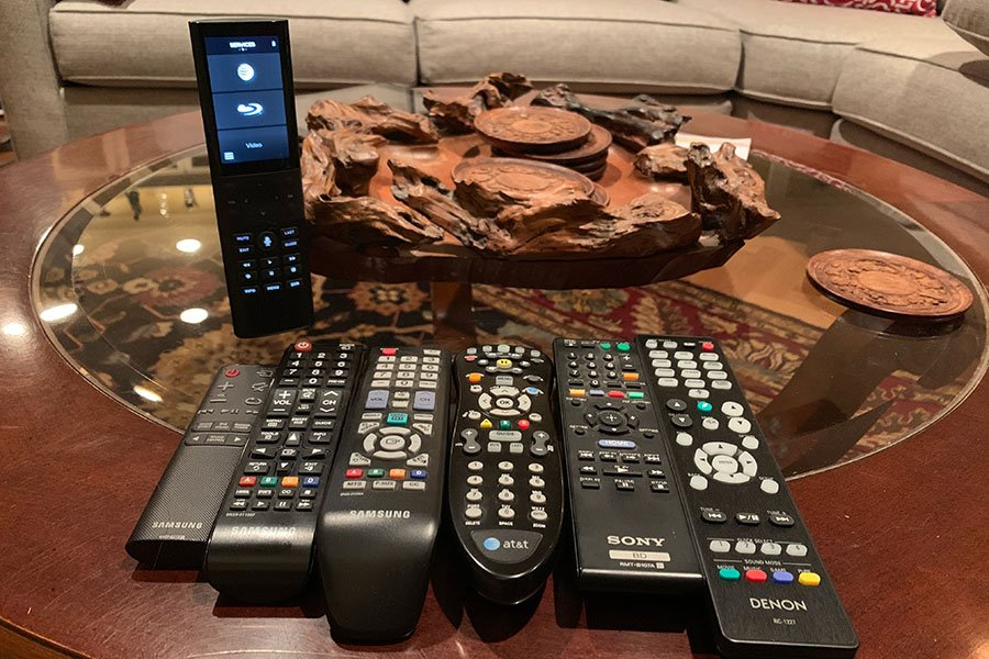 Savant Systems handheld remote (pictured upper left) replaces all existing AV controls. Installed by Vox Audio Visual Elite Services - a Savant authorized dealer.